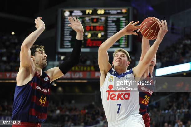Luka Doncic #7 guard of Real Madrid and Ante Tomic #44 center of FC Barcelona during the Liga Endesa game between Real Madrid v FC Barcelona at...