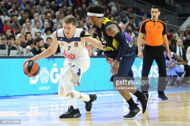 Luka Doncic #7 guard of Real Madrid and Bobby Dixon #35 guard of Fenerbahce Ulker Istanbul during the 2016/2017 Turkish Airlines Euroleague Regular...