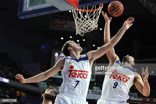 Luka Doncic #7 guard of Real Madrid and Felipe Reyes #9 forward of Real Madrid captures a rebound during the Liga Endesa game between Real Madrid and...
