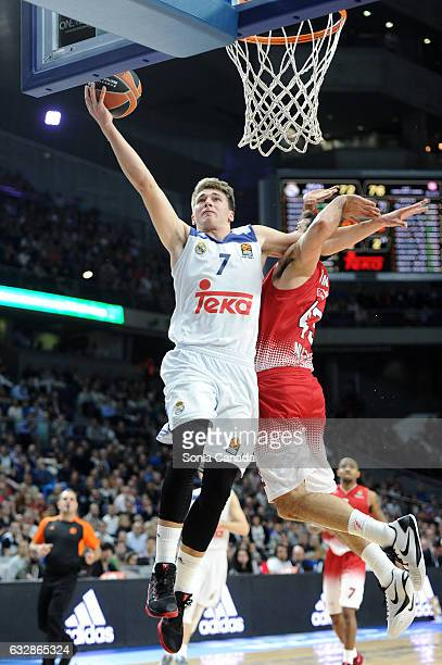 Luka Doncic #7 guard of Real Madrid and Krunoslav Simon #43 forward of EA7 Emporio Armani Milan during the 2016/2017 Turkish Airlines Euroleague...