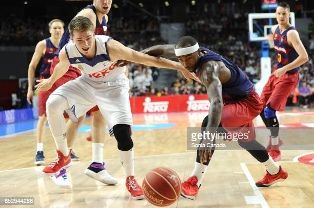 Luka Doncic #7 guard of Real Madrid and Tyrese Rice #2 guard of FC Barcelona during the Liga Endesa game between Real Madrid v FC Barcelona at...