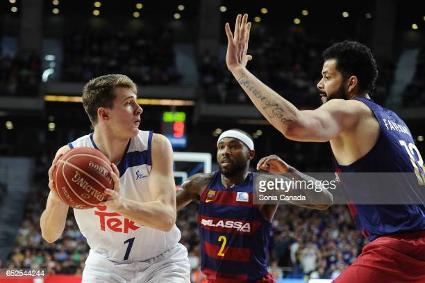 Luka Doncic #7 guard of Real Madrid and Vitor Faverani #13 center of FC Barcelona during the Liga Endesa game between Real Madrid v FC Barcelona at...