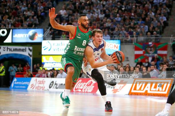 Luka Doncic #7 of Real Madrid competes with Adam Hanga #8 of Baskonia Vitoria Gasteiz during the 2016/2017 Turkish Airlines EuroLeague Regular Season...