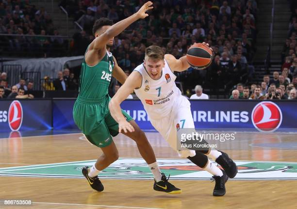 Luka Doncic #7 of Real Madrid competes with Axel Toupane #6 of Zalgiris Kaunas in action during the 2017/2018 Turkish Airlines EuroLeague Regular...