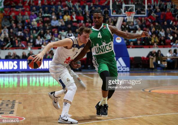 Luka Doncic #7 of Real Madrid competes with Coty Clarke #4 of Unics Kazan during the 2016/2017 Turkish Airlines EuroLeague Regular Season Round 22...