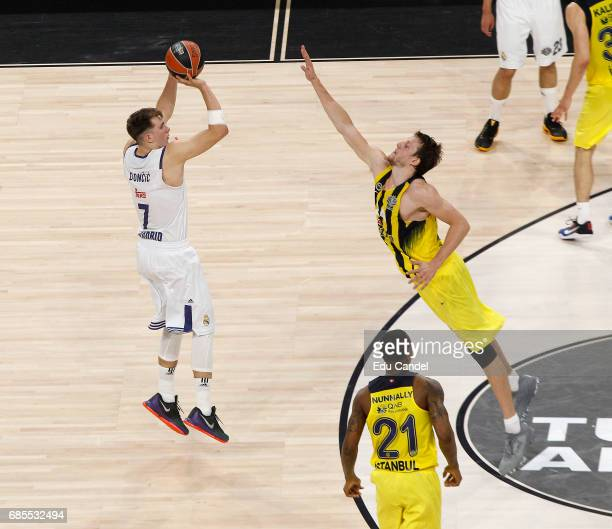Luka Doncic #7 of Real Madrid competes with Jan Vesely #24 of Fenerbahce Istanbul in action during the Turkish Airlines EuroLeague Final Four...