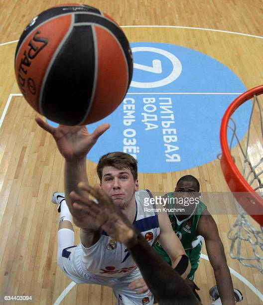Luka Doncic #7 of Real Madrid competes with Latavious Williams #22 of Unics Kazan during the 2016/2017 Turkish Airlines EuroLeague Regular Season...