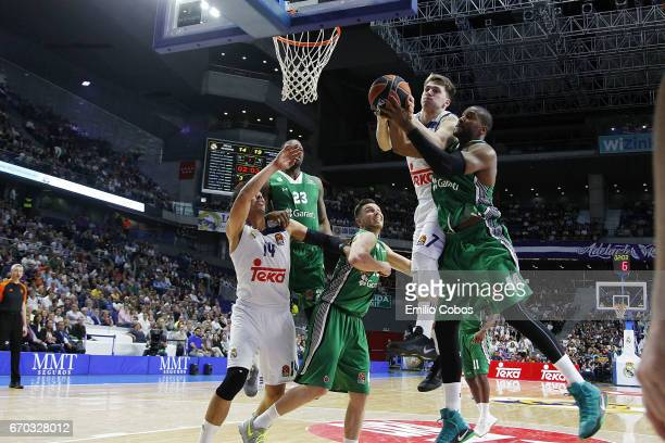Luka Doncic #7 of Real Madrid competes with Marcus Slaughter #44 of Darussafaka Dogus Istanbul during the 2016/2017 Turkish Airlines EuroLeague...