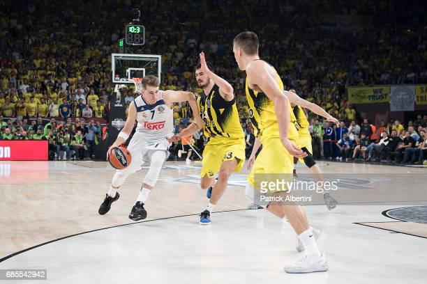 Luka Doncic #7 of Real Madrid competes with Nikola KalinicÊ#33 of Fenerbahce Istanbul during the Turkish Airlines EuroLeague Final Four Semifinal A...
