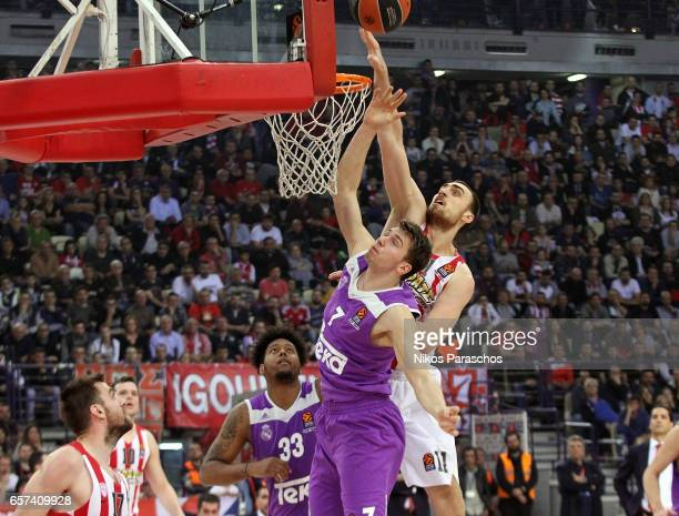 Luka Doncic #7 of Real Madrid competes with Nikola Milutinov #11 of Olympiacos Piraeus during the 2016/2017 Turkish Airlines EuroLeague Regular...