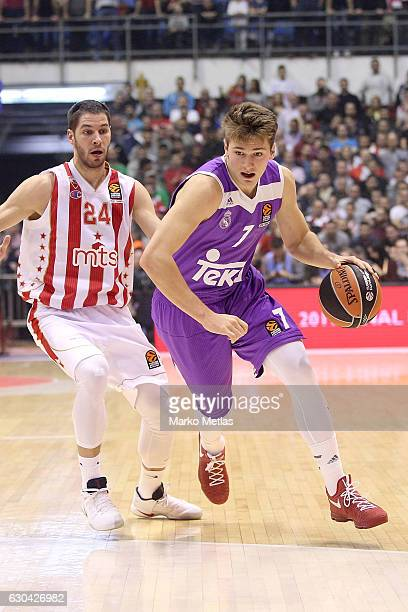 Luka Doncic #7 of Real Madrid competes with Stefan Jovic #24 of Crvena Zvezda mts Belgrade during the 2016/2017 Turkish Airlines EuroLeague Regular...