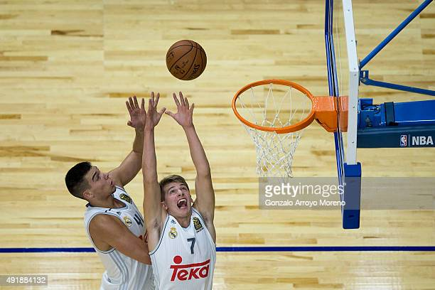 Luka Doncic of Real Madrid and his teammate Guillermo Hernangomez goes up for a rebound during the friendlies of the NBA Global Games 2015 basketball...