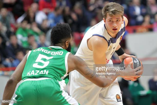 Luka Doncic of Real Madrid in action against Keith Langford of UNICS Kazan during the Turkish Airlines EuroLeague match between UNICS Kazan and Real...