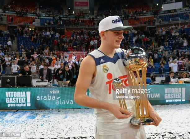 Luka Doncic of Real Madrid poses with tropy after winning Copa del Rey's final match between Real Madrid and Valencia BC at Fernando Buesa Arena in...