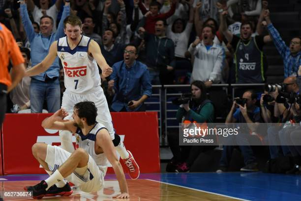 Luka Doncic up #7 guard of Real Madrid and Sergio Llull #23 guard of Real Madrid celebrate the victory during the Liga Endesa game between Real...