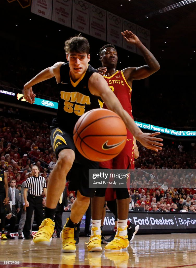 Luka Garza #55 of the Iowa Hawkeyes battles for the ball with Cameron Lard #2 of the Iowa State Cyclones in the second half of play at Hilton Coliseum on December 7, 2017 in Ames, Iowa. The Iowa State Cyclones won 84-78 over the Iowa Hawkeyes.