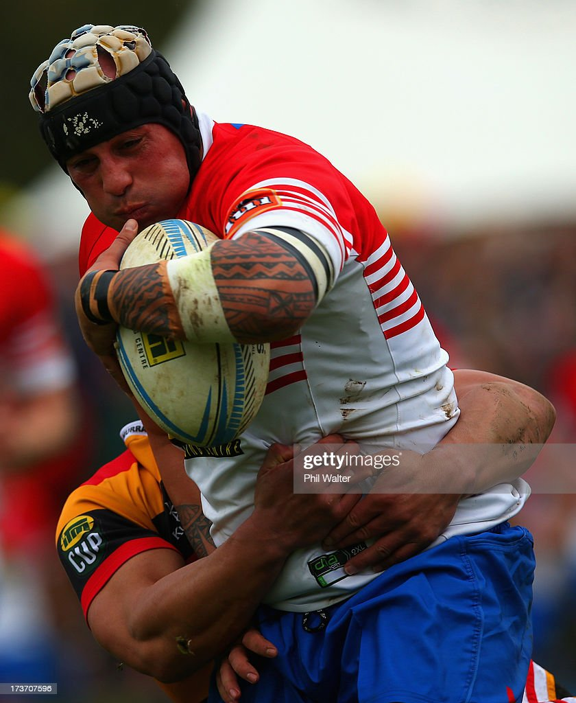 Luka Gibb of Horowhenua-Kapiti is tackled during the Ranfurly Shield match between Waikato and Horowhenua-Kapiti at the Morrinsville Domain on July 17, 2013 in Morrinsville, New Zealand.
