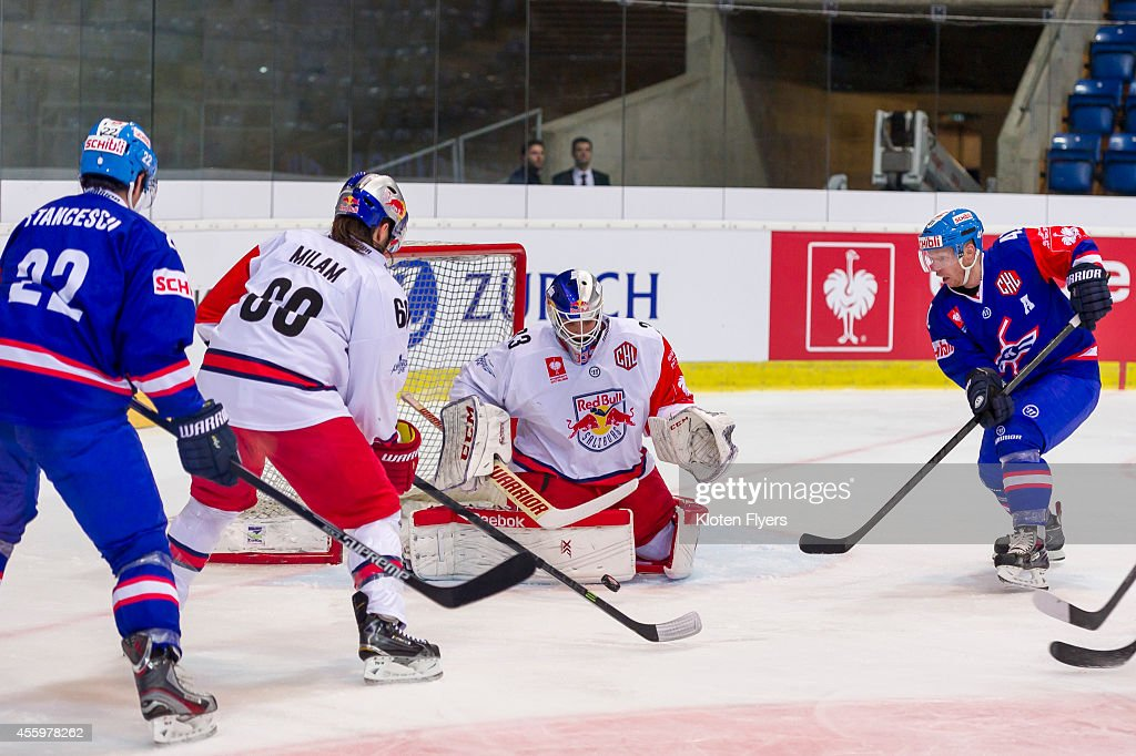 Luka Gracnar #33 from Red Bull Salzburg makes a save during the Champions Hockey League group stage game between Kloten Flyers and Red Bull Salzburg on September 23, 2014 in Kloten, Switzerland.