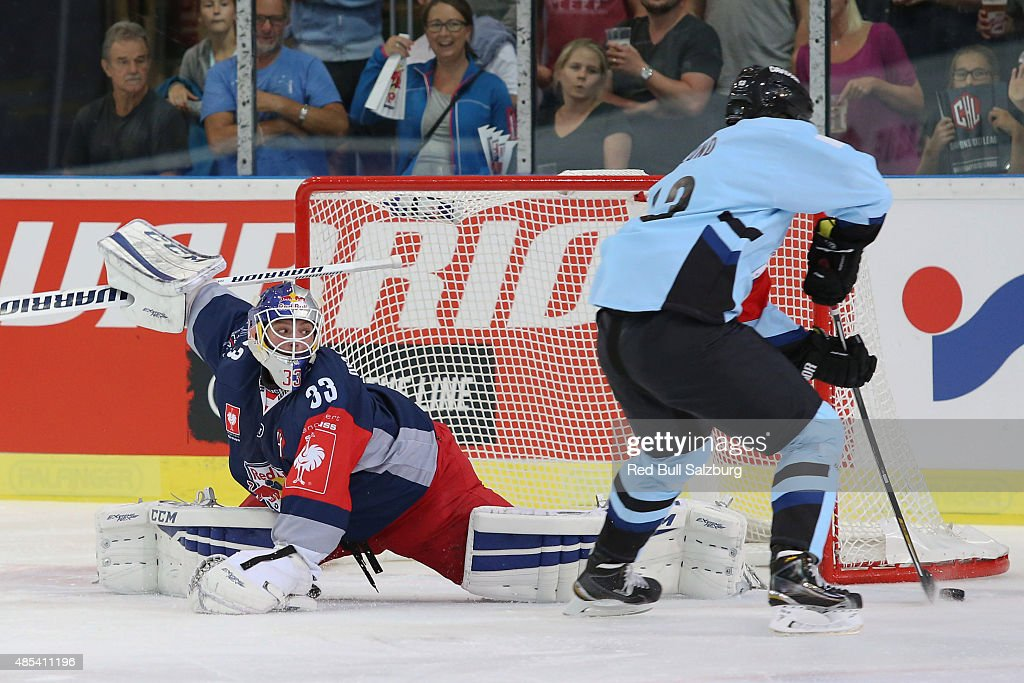Luka Gracnar of EC Red Bull Salzburg and Mads Lund of SonderjyskE Vojens during the Champions Hockey League group stage game on August 27, 2015 in Salzburg, Austria.