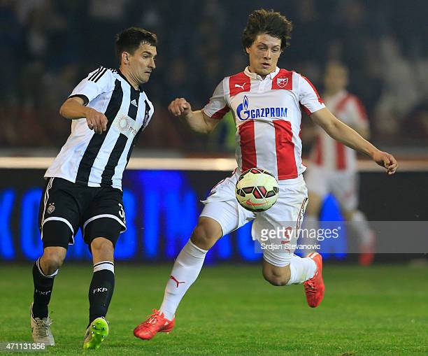Luka Jovic of Crvena Zvezda in action against Branko Ilic of Partizan during the Serbian Super League match between FK Crvena Zvezda and FK Partizan...