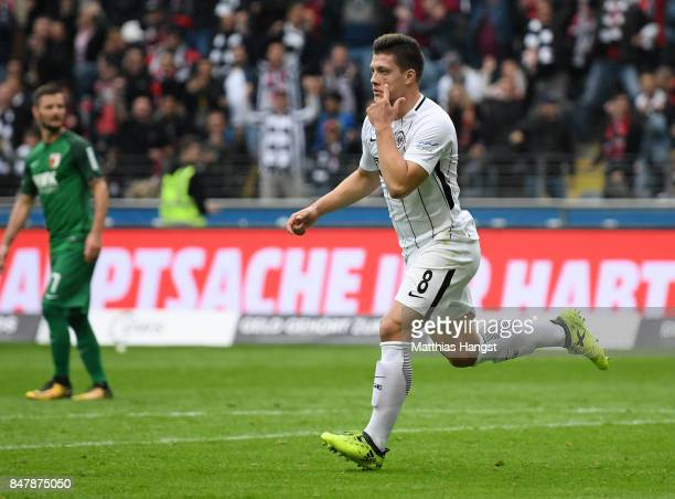Luka Jovic of Frankfurt celebrates after scoring his team's first goal during the Bundesliga match between Eintracht Frankfurt and FC Augsburg at...