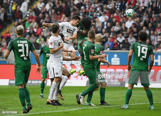 Luka Jovic of Frankfurt scores his team's first goal during the Bundesliga match between Eintracht Frankfurt and FC Augsburg at CommerzbankArena on...