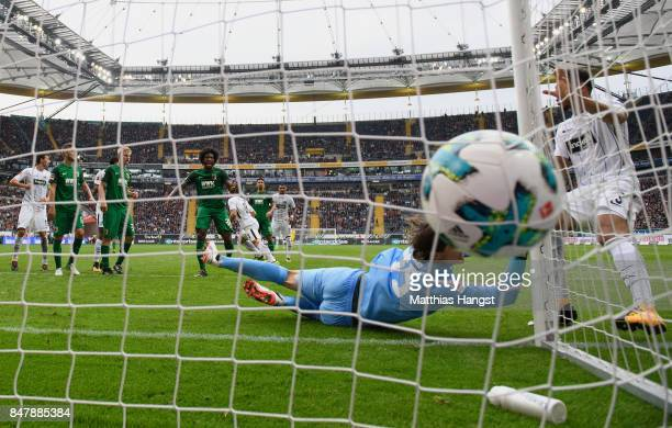 Luka Jovic of Frankfurt scores his team's first goal past goalkeeper Marwin Hitz of Augsburg during the Bundesliga match between Eintracht Frankfurt...