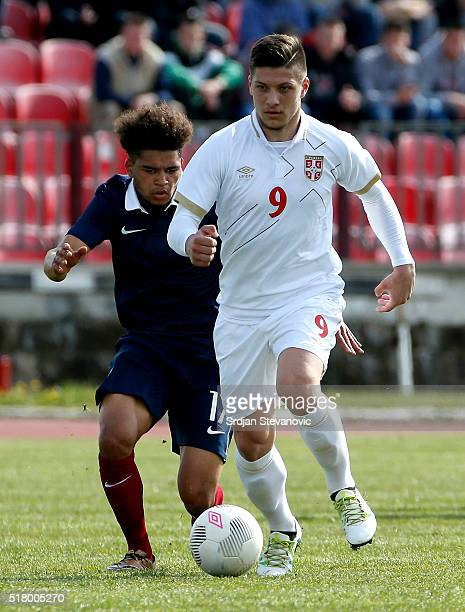 Luka Jovic of Serbia in action against Denis Will Poha of France during the UEFA European U19 Championship Elite Round Group 7 match between Serbia...