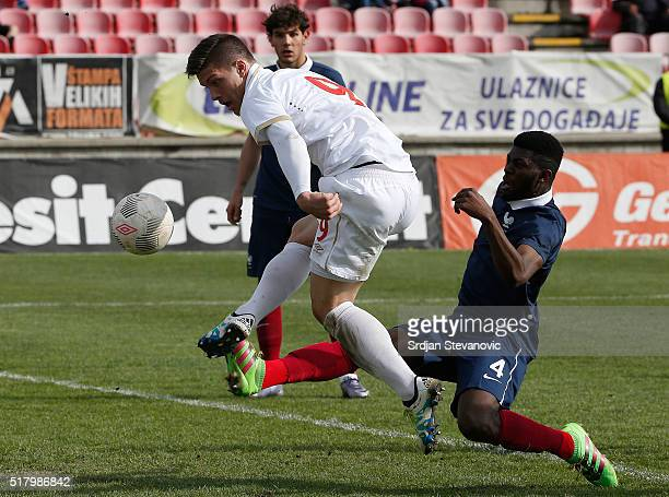 Luka Jovic of Serbia in action aginst Jerome Onguene of france during the UEFA European U19 Championship Elite Round Group 7 match between Serbia and...