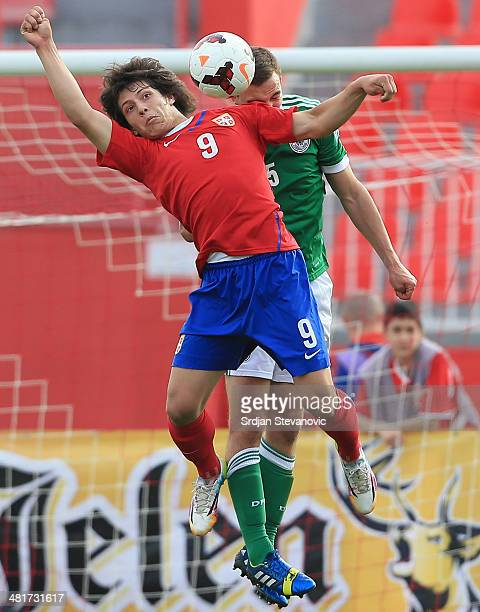 Luka Jovic of Serbia jumps for the ball against Benedikt Gimber of Germany during the UEFA Under17 Elite Round between Serbia and Germany at Stadion...