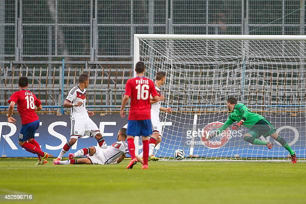 Luka Jovic of Serbia scores past Goalkeeper Oliver Schnitzler of Germany during the UEFA Under19 European Championship match between U19 Germany and...