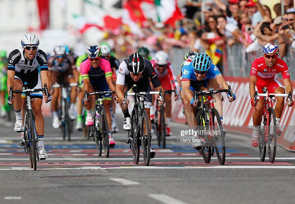 Luka Mezgec of Slovenia and team GiantShimano crosses the line to win the twentyfirst stage of the 2014 Giro d'Italia a 172km stage between Gemona...