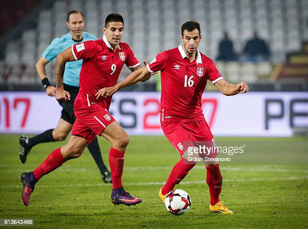 Luka Milivojevic and Aleksandar Mitrovic of Serbia in action during the FIFA 2018 World Cup Qualifier between Serbia and Austria at stadium Rajko...