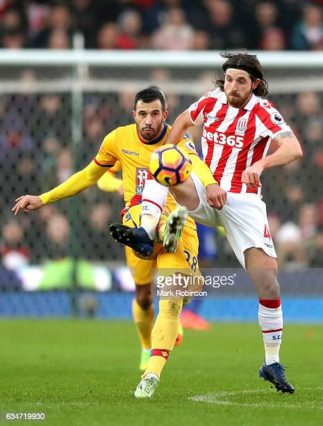 Luka Milivojevic of Crystal Palace and Joe Allen of Stoke City compete for the ball during the Premier League match between Stoke City and Crystal...