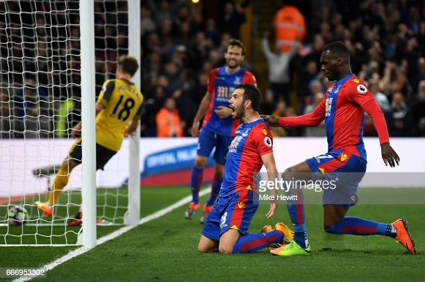 Luka Milivojevic of Crystal Palace celebrates as he scores their third goal from a penalty with Christian Benteke of Crystal Palace during the...