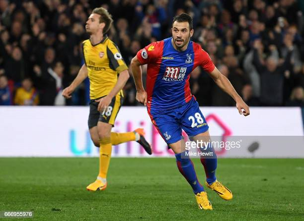 Luka Milivojevic of Crystal Palace celebrates as he scores their third goal from a penalty during the Premier League match between Crystal Palace and...