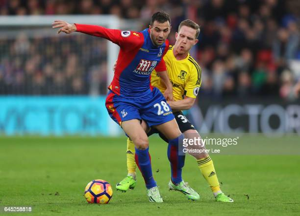 Luka Milivojevic of Crystal Palace is put under pressure from Adam Forshaw of Middlesbrough during the Premier League match between Crystal Palace...