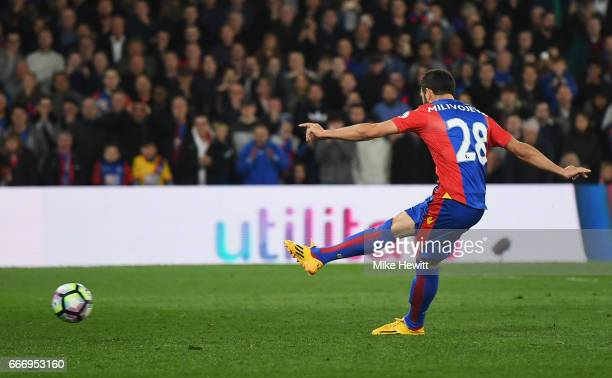 Luka Milivojevic of Crystal Palace scores their third goal from a penalty during the Premier League match between Crystal Palace and Arsenal at...