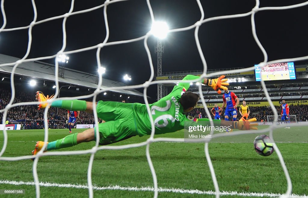 Luka Milivojevic of Crystal Palace scores their third goal from a penalty past goalkeeper Emiliano Martinez of Arsenal during the Premier League match between Crystal Palace and Arsenal at Selhurst Park on April 10, 2017 in London, England.