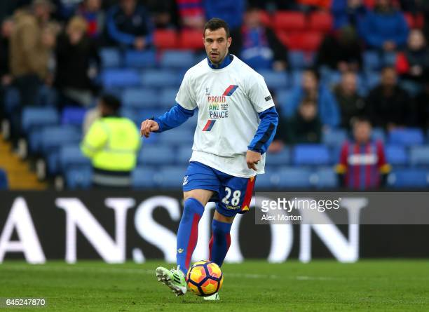 Luka Milivojevic of Crystal Palace warms up while wearing a Pride of Palace tshirt during the Premier League match between Crystal Palace and...