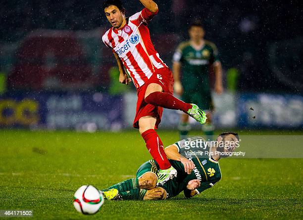 Luka Milivojevic of Olympiacos fouls Tasos Lagos of Panathinaikos during the Superleague match between Panathinaikos FC and Olympiacos at Apostolos...