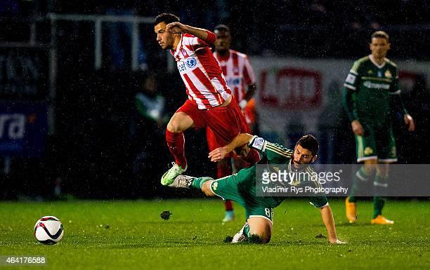 Luka Milivojevic of Olympiacos passes over Tasos Lagos of Panathinaikos during the Superleague match between Panathinaikos FC and Olympiacos at...