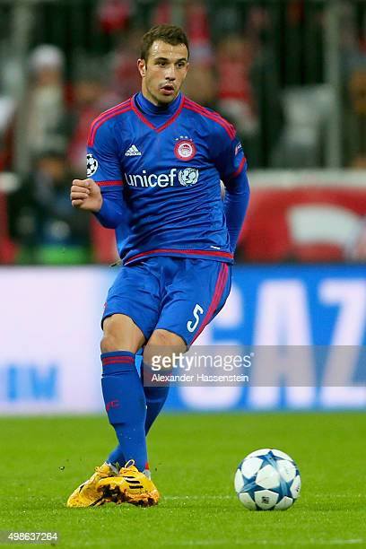 Luka Milivojevic of Olympiacos runs with the ball during the UEFA Champions League Group F match between FC Bayern Muenchen and Olympiacos FC at...