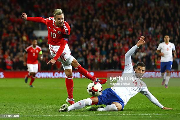 Luka Milivojevic of Serbia blocks the attempt on goal of Aaron Ramsey of Wales during the FIFA 2018 World Cup Qualifier between Wales and Serbia at...