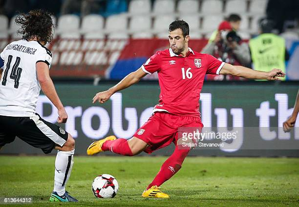 Luka Milivojevic of Serbia in action against against Julian Baumgartlinger of Austria during the FIFA 2018 World Cup Qualifier between Serbia and...