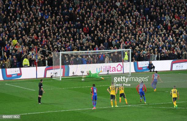 Luka Milivojevic scores Palace 3rd goal past Emiliano Martinez of Arsenal during the Premier League match between Crystal Palace and Arsenal at...