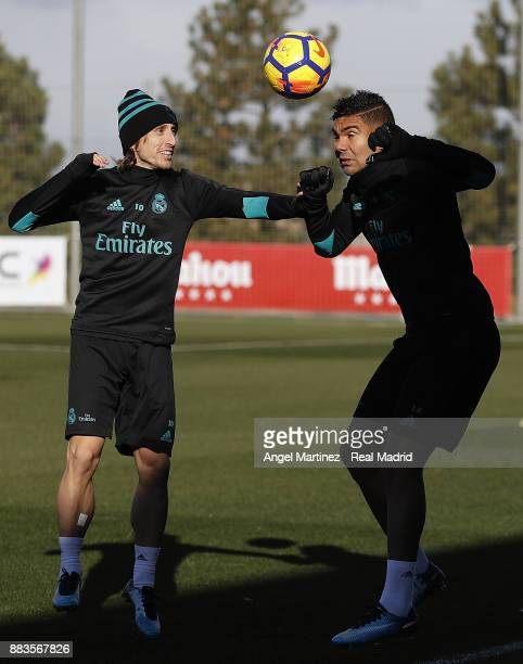 Luka Modric and Casemiro of Real Madrid in action during a training session at Valdebebas training ground on December 1 2017 in Madrid Spain