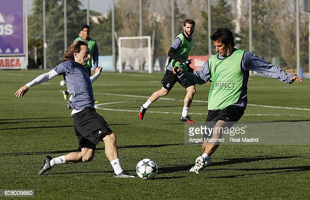 Luka Modric and Fabio Coentrao of Real Madrid in action during a training session at Valdebebas training ground on December 6 2016 in Madrid Spain