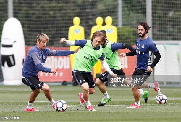 Luka Modric and Fabio Coentrao of Real Madrid warm up during a training session at Valdebebas training ground on May 5 2017 in Madrid Spain
