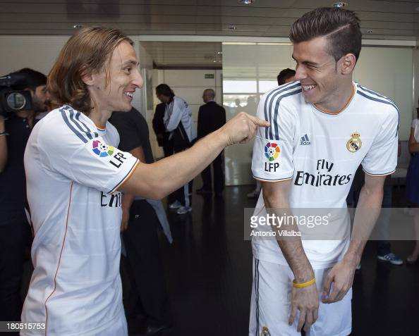 Luka Modric and Gareth Bale of Real Madrid joke during the official team photo session at Valdebebas training ground on September 13 2013 in Madrid...